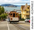 SAN FRANCISCO, CA - CIRCA JULY 2014 - Cable cars traffic in San Francisco, CA, circa July 2014. Cable car, an iconic tourist attraction - stock photo