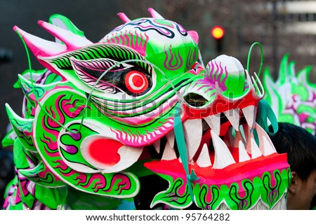 SAN FRANCISCO, CA - FEBRUARY 11:  A head of a dragon costume during the Chinese New Year Parade in San Francisco. It is the largest Asian event in North America. February 11, 2012 in San Francisco, CA - stock photo
