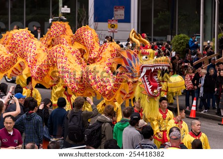 SAN FRANCISCO, CA - February 19, 2015 - San Francisco Chinese perform traditional dance with Chinese Dragon on New Years Day. - stock photo