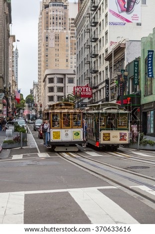 SAN FRANCISCO Ca. - JUNE 16: Passengers ride in a cable car  JUNE 16, 2015 in San Francisco. It is the most popular way to get around the City of San Fransisco. - stock photo