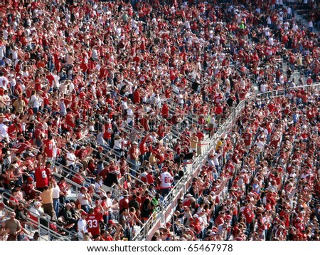 SAN FRANCISCO, CA - NOVEMBER 14: Rams vs. 49ers: 49ers Fans cheer and celebrate with each other a successful play by the 49ers on November 14 2010 at Candlestick Stadium San Francisco California. - stock photo