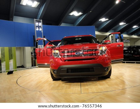 SAN FRANCISCO, CA - NOVEMBER 20: Red Ford Truck on display at the 53rd International Auto Show on November 20, 2010 in San Francisco, CA. - stock photo