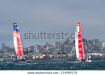 SAN FRANCISCO, CA - OCTOBER 4: Emirates Team New Zealand and Italy's Team Luna Rossa Piranha compete in the America'?s Cup World Series sailing races in San Francisco, CA on October 4, 2012 - stock photo