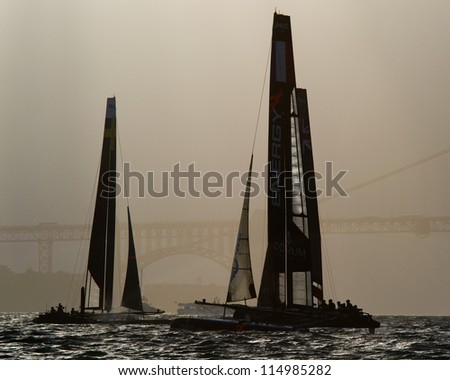 SAN FRANCISCO, CA - OCTOBER 4: Energy Team and Artemis Red compete in the America'??s Cup World Series sailing races in San Francisco, CA on October 4, 2012 - stock photo