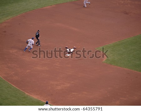 SAN FRANCISCO, CA - OCTOBER 28: Giants Cody Ross slides into second hands first during double game 2 of the 2010 World Series game between Giants and Rangers Oct. 28, 2010 AT&T Park San Francisco, CA - stock photo