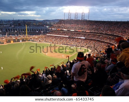 SAN FRANCISCO, CA - OCTOBER 28: Giants fans cheer waving rags in anticipation of upcoming pitch game 2 of the 2010 World Series game between Giants and Rangers Oct. 28, 2010 AT&T Park San Francisco. - stock photo