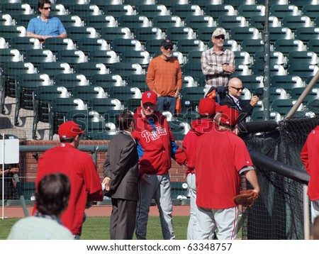 SAN FRANCISCO, CA - OCTOBER 19: Giants vs. Phillies: Manager Charlie Manuel talks to reporter outside the batting cage during NLCS 2010 taken October 19, 2010 AT&T Park San Francisco California. - stock photo