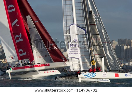 SAN FRANCISCO, CA - OCTOBER 4: Luna Rossa Piranha and Team China compete in the America'??s Cup World Series sailing races in San Francisco, CA on October 4, 2012 - stock photo