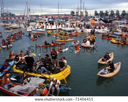 SAN FRANCISCO, CA - OCTOBER 27: McCovey Cove fill with kayaks, boats, and people having fun during game 1 of the 2010 World Series Oct. 27, 2010 AT&T Park San Francisco, CA. - stock photo