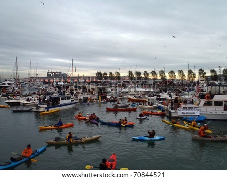 SAN FRANCISCO, CA - OCTOBER 27: McCovey Cove filled with boats and people as birds fly over head during game 1 of the 2010 World Series Oct. 27, 2010 AT&T Park San Francisco, CA. - stock photo