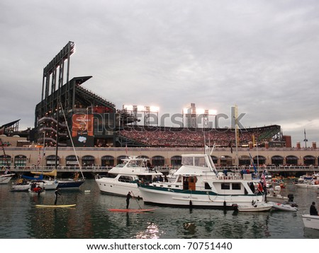 SAN FRANCISCO, CA - OCTOBER 27: McCovey Cove filled with boats and people during game 1 of the 2010 World Series game between Giants and Rangers Oct. 27, 2010 AT&T Park San Francisco, CA. - stock photo