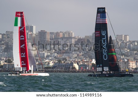 SAN FRANCISCO, CA - OCTOBER 4: Oracle Team USA and Italy's Team Luna Rossa Piranha compete in the America'??s Cup World Series sailing races in San Francisco, CA on October 4, 2012 - stock photo