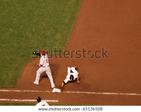 SAN FRANCISCO, CA - OCTOBER 20: Runner Andres Torres slides  back into base as Ryan Howard catches ball plays game 4 2010 NLCS game between Giants and Phillies Oct. 20, 2010 AT&T Park San Francisco.