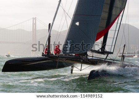 SAN FRANCISCO, CA - OCTOBER 4: Sweden's Artemis Racing Red sailboat skippered by Nathan Outteridge competes in the America'?s Cup World Series sailing races in San Francisco, CA on October 4, 2012 - stock photo