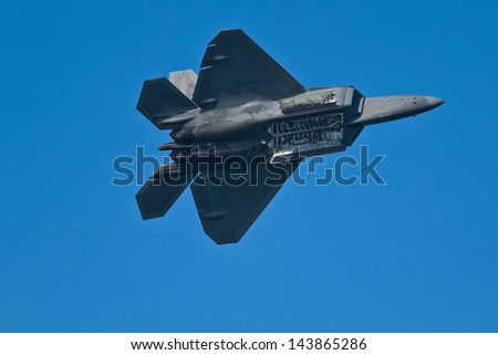 SAN FRANCISCO, CA - OCTOBER 7:  USAF F-22 Raptor aircraft demonstration during Fleet Week in San Francisco, CA on October 7, 2012 - stock photo