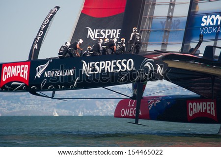 SAN FRANCISCO, CA - SEPTEMBER 12: Emirates Team New Zealand competes in the America's Cup sailing races in San Francisco, CA on September 12, 2013 - stock photo