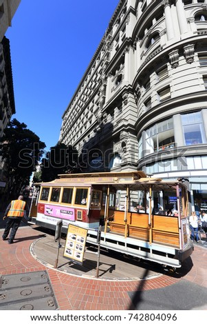 San Francisco, CA, United States - September 19, 2017: Historical iconic San Francisco cable car, serving at Powell & hyde street line, turns around in Powell street station.