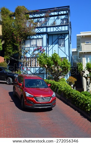 SAN FRANCISCO CA USA APRIL 15: Lombard Street is an east-west street in San Francisco California on april 15 2015. The street is known as the most crooked street in the world - stock photo