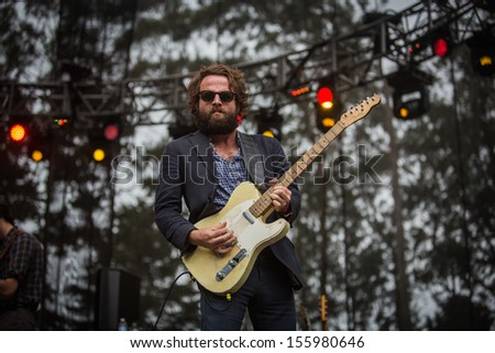 San Francisco, CA USA - August 11, 2013: Taylor Goldsmith of Dawes performing at the 2013 Outside Lands music festival in Golden Gate Park.  - stock photo