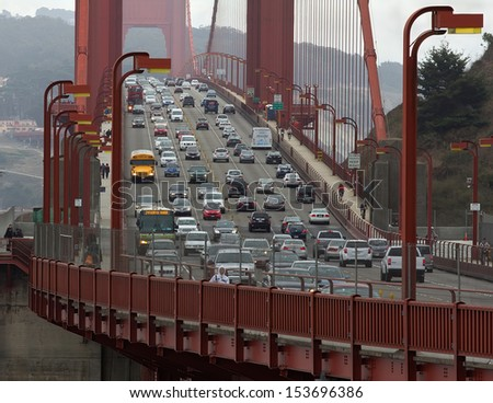 SAN FRANCISCO, CA,USA - SEPTEMBER 10: Golden Gate bridge with cars, trucks, buses, pedestrians and cyclists at 3.30 pm on September 10,2013  - stock photo