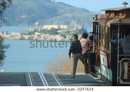 San Francisco cable car and view of alcatraz island - stock photo