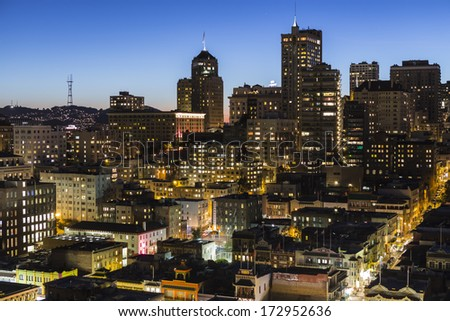 SAN FRANCISCO, CALIFORNIA - January 13, 2013:  Dusk view of Chinatown and Nob Hill in downtown San Francisco. - stock photo