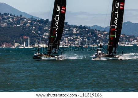 SAN FRANCISCO, CALIFORNIA, USA - AUGUST 25, 2012: Team Oracle USA racing in Louis Vuitton Cup part of the America's Cup World Series on August 25, 2012 in San Francisco Bay, California - stock photo