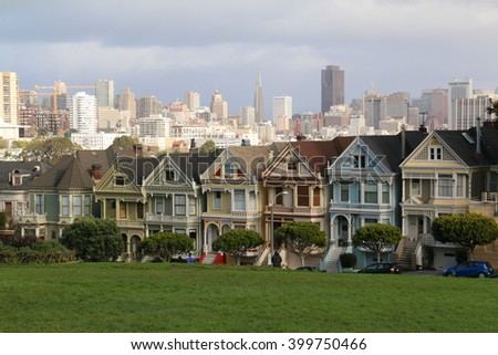 San Francisco, California, USA - December 24,2015: Painted Ladies across from Alamo Square park, known as Postcard Row, often appears in media and mass-market photographs of the city.