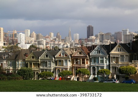 San Francisco, California,USA - December 24, 2015: Painted Ladies across from Alamo Square park in San Francisco, known as Postcard Row, often appears in media and mass-market photographs of the city.