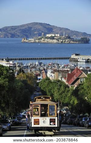 SAN FRANCISCO, California, USA, - NOVEMBER. 8. 2011: The Cable car tram in San Francisco, world's last manually-operated cable car system, icon of San Francisco - stock photo