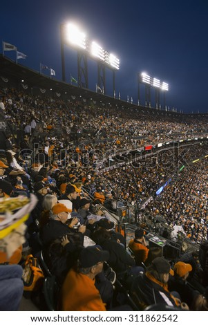 San Francisco, California, USA, October 16, 2014, AT&T Park, baseball stadium, SF Giants versus St. Louis Cardinals, National League Championship Series (NLCS), crowd watches game elevated view - stock photo