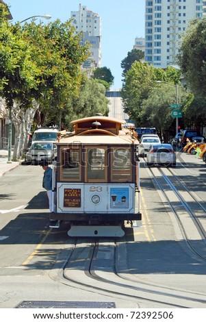 SAN FRANCISCO - CIRCA JUNE 09: Cable car tram circa June 09 in San Francisco, USA. The San Francisco cable car system is world last permanently operational manually operated cable car system. - stock photo