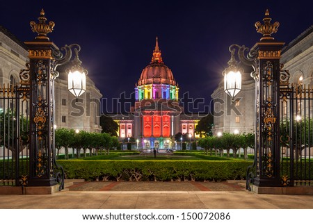 San Francisco City Hall illuminated in rainbow colors in honor of Pride Week. - stock photo