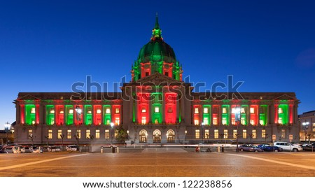 San Francisco City Hall in red and green light around Christmas. - stock photo