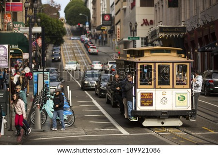 SAN FRANCISCO - DECEMBER 29: The Cable car tram, December 29, 2013 in San Francisco, USA. The San Francisco cable car system is world last permanently manually operated cable car system. - stock photo