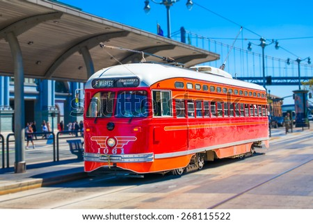 San Francisco f- streetcar, tram or muni trolley traveling down the Embarcadero on a sunny day.  Vintage streetcar originally a Pacific Electric car built in 1948 trolley.  Tribute livery.
