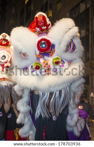 SAN FRANCISCO - FEB 15 : An unidentified participant in a Lion dance at the Chinese New Year Parade in San Francisco , California on February 15 2014 , It is the largest Asian event in North America