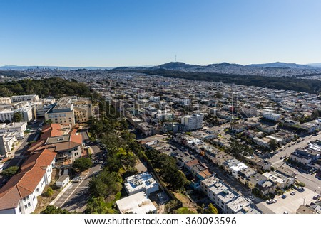 San Francisco from above on a brilliant afternoon, looking over the Richmond district and Land's End with Golden Gate Park, Mt Sutro, and the downtown skyline in the distance - stock photo