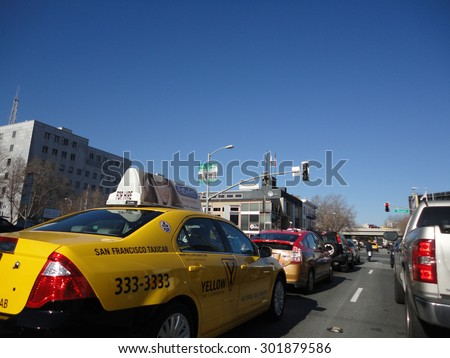 SAN FRANCISCO - JANUARY 27: Cabs, Cars, and Trucks wait in traffic during red light on busy street in San Francisco January 27, 2011.  San Francisco regularly ranks in the top worst traffic in nation. - stock photo