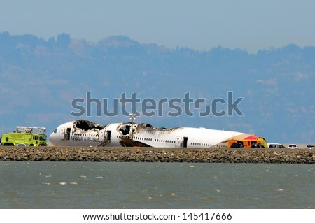 SAN FRANCISCO - JULY 9: Boeing 777 Asiana Airlines Flight 214 being investigated by the NTSB after crash landing at San Francisco Airport on July 6, 2013 - stock photo