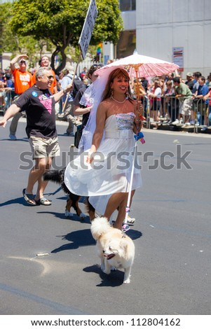 SAN FRANCISCO - JUNE 24: San Francisco Gay Pride Parade 2012. It is one of the largest gathering of LGBT people and allies in the USA. June 24, 2012 in San Francisco - stock photo
