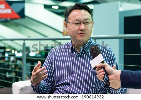 SAN FRANCISCO - MARCH 20: Shuhei Yoshida, Sony world wide studios president, giving interviews about Morpheus and PlayStation 4 at GDC 2014 on March 20, 2014 in San Francisco, CA - stock photo