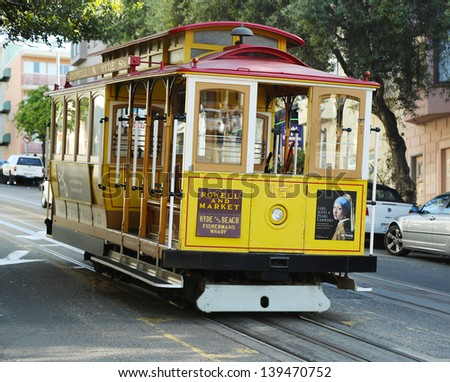 SAN FRANCISCO -MARCH 28: The famous cable car on March 28, 2013 in San Francisco, USA. The San Francisco cable car is world last permanently manually operated cable car system - stock photo