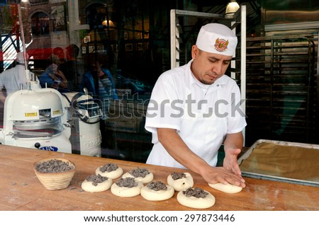SAN FRANCISCO - MAY 21 2015:Baker prepair bread in Boudin Bakery in San Francisco CA.The bakery still uses the same starter yeast bacteria culture it developed during the California Gold Rush