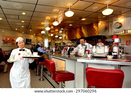 SAN FRANCISCO - MAY 17 2015:Classic American Diner in San Francisco,CA.Diners are popular American urban culture open 24/7 and serve American food such as hamburgers, french fries and club sandwiches. - stock photo