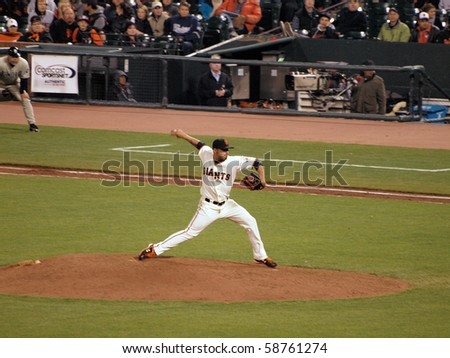SAN FRANCISCO - MAY 11: Giants Vs. Padres: Giants pitcher Sergio Romo steps forward to throw a pitch in relief during a night game.  Taken May 11 2010 at Att Park San Francisco California - stock photo