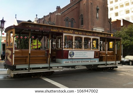 SAN FRANCISCO - MAY 25:Passengers enjoy a ride in a cable car on  MAY 25, 2012 in San Francisco, oldest mechanical public transport in San Francisco, since 1873 - stock photo