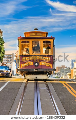 SAN FRANCISCO - NOVEMBER 26, 2010: Passengers enjoy a ride in a cable car in San Francisco, California. It is the oldest mechanical public transport in San Francisco which is in service since 1873. - stock photo