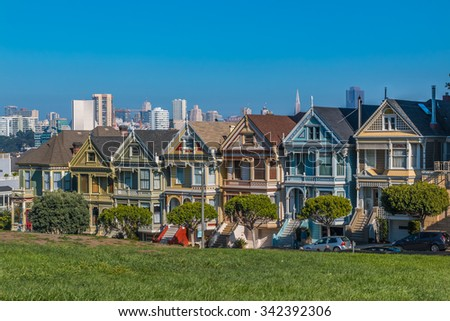 San Francisco - November 14, 2015: San Francisco cityscape with the Painted Ladies Victorian houses as seen from Alamo square park