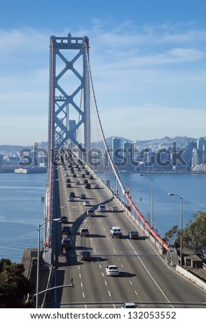 SAN FRANCISCO - NOVEMBER 3: The Bay Bridge on November 3rd, 2012 in San Francisco, USA. The Bay Bridge was opened for traffic on November 12, 1936 and carries approximately 270,000 vehicles per day - stock photo